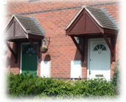 Photo showing two front doors of houses