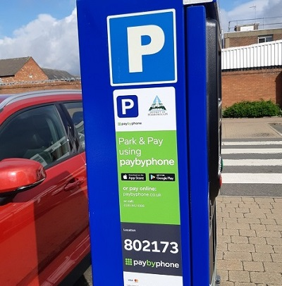 Pay by phone sticker on parking machine