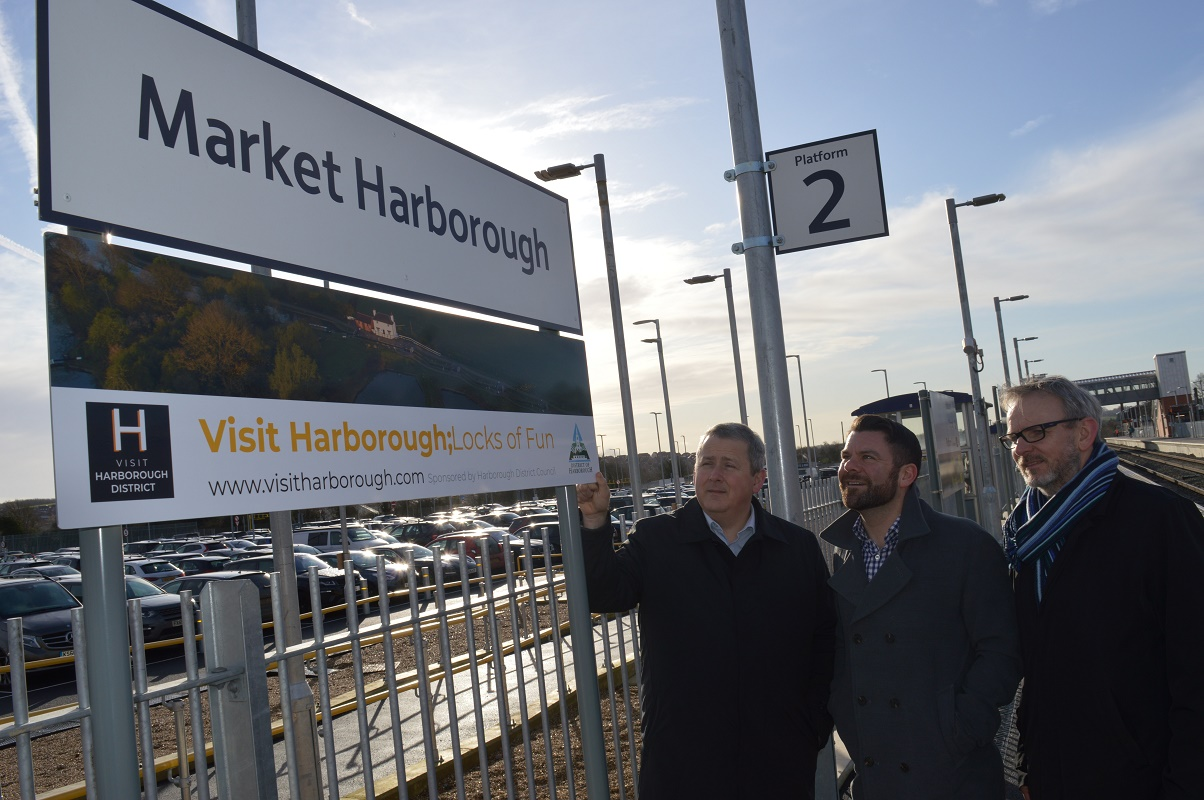 Train station Visit Harborough District sign